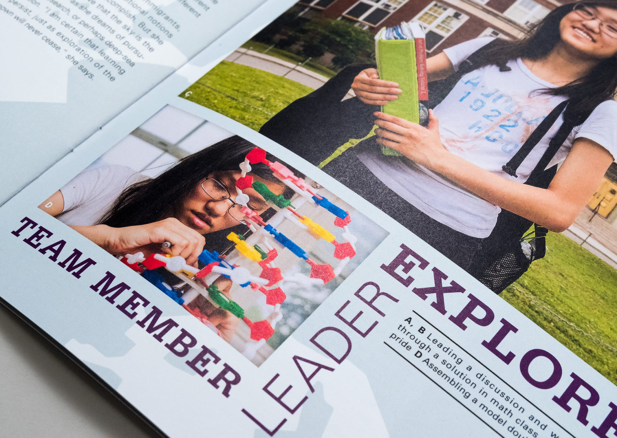 "Detail of student profile page for Emily Lin showing a photograph of her building a model of DNA with the words ""Team Member, Leader, Explorer"" surrounding it"
