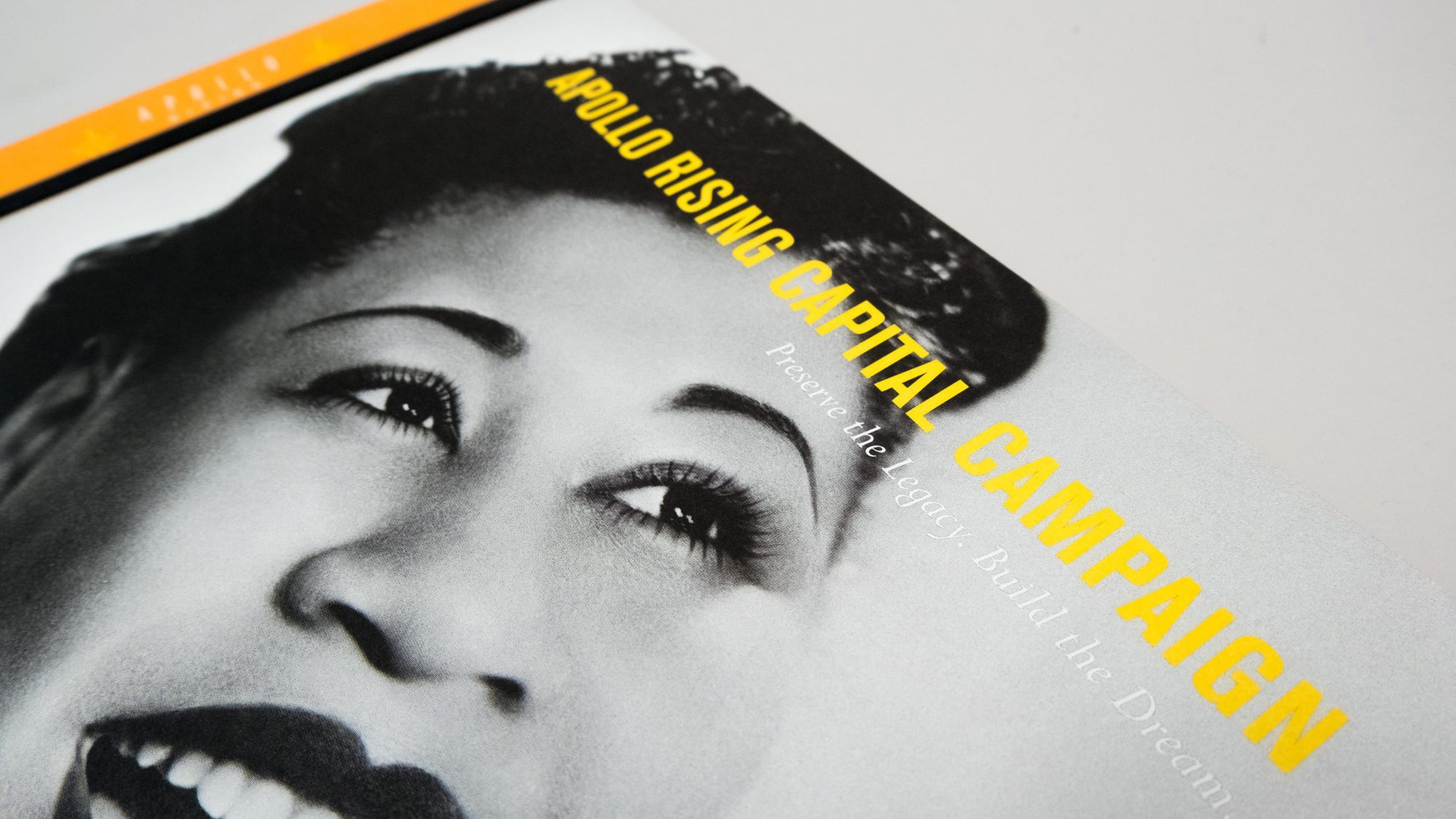 Cover design of caste statement with Apollo Rising title and black and white photo of Billie Holiday